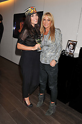 Left to right, GRACE WOODWARD and MEG MATTHEWS at a lunch hosted by Harrods' and Erno Laszlo to celebrate the launch of the Erno Laszlo Hollywood Collection held in The Penthouse, Harrods, Knightsbridge, London on 25th April 2012.