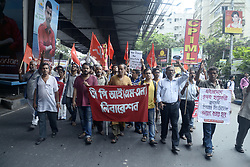 June 9, 2017 - Kolkata, West Bengal, India - Activist shout slogan and show poster against Madhya Pradesh Chief Minister Shivraj Chouhan in Kolkata. Communist Party of India (Marxist - Leninist) activist protest against killing of five farmers Madhya Pradesh Mandsaur district in Kolkata. At least five farmers were killed and several injured in Mandsaur district on Tuesday when police fired on protesters demanding better prices in the drought-ravaged region that recorded a farm suicide every five hours in 2016-17. (Credit Image: © Saikat Paul/Pacific Press via ZUMA Wire)