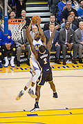 Golden State Warriors forward Andre Iguodala (9) takes the ball to the basket over Indiana Pacers guard Rodney Stuckey (2) at Oracle Arena in Oakland, Calif., on December 5, 2016. (Stan Olszewski/Special to S.F. Examiner)