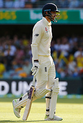 England's James Vince walks off dejected after being runout by Nathan Lyon during day one of the Ashes Test match at The Gabba, Brisbane.