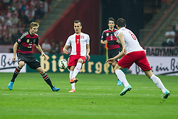 11.10.2014, National Stadium, Warsaw, POL, UEFA Euro Qualifikation, Polen vs Deutschland, Gruppe D, im Bild CHRISTOPH KRAMER ( L) ARKADIUSZ MILIK ( C) // during the UEFA EURO 2016 Qualifier group D match between Poland and Germany at the National Stadium in Warsaw, Poland on 2014/10/11. EXPA Pictures © 2014, PhotoCredit: EXPA/ Newspix/ Katarzyna Plewczynska<br /> <br /> *****ATTENTION - for AUT, SLO, CRO, SRB, BIH, MAZ, TUR, SUI, SWE only*****