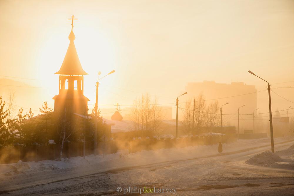 Winter street scene with Church, Tynda, Amur region, Siberia, Russia