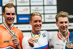 March 2, 2018 - Apeldoorn, Netherlands - (L/R) Sliver medalist Netherland's Jan Willem Van Schip, Gold medalist Australian Cameron Meyer and Bronze medalist Britton Mark Stweart pose on the podium after the men's points race final during the UCI Track Cycling World Championships in Apeldoorn on March 2, 2018. (Credit Image: © Foto Olimpik/NurPhoto via ZUMA Press)