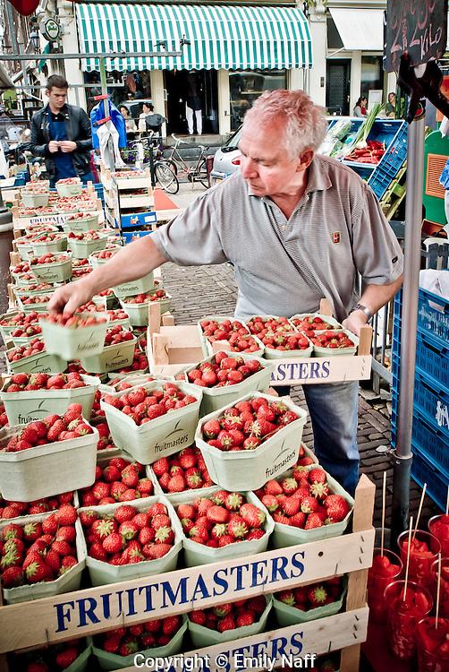 Vendor selling strawberries at Noordermarkt, Amsterdam.