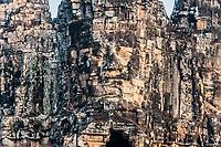 giant face at south gate bridge Angkor Thom Cambodia