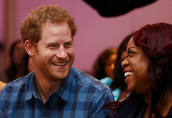 Prince Harry watches the rehearsal by the Joyful Noise choir, a group from NAZ, a sexual health charity for minority communities, at The Hurlingham club in London.