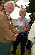 Hugh Hudson and Nettie Mason, Cartier Style Et Luxe, Goodwood, 27 June 2004. SUPPLIED FOR ONE-TIME USE ONLY-DO NOT ARCHIVE. © Copyright Photograph by Dafydd Jones 66 Stockwell Park Rd. London SW9 0DA Tel 020 7733 0108 www.dafjones.com