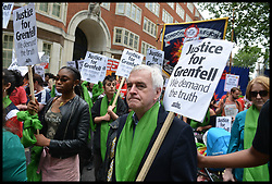 June 16, 2018 - London, London, United Kingdom - Grenfell solidarity march. Shadow Chancellor of the Exchequer John McDonnell joins the Justice4Grenfell and the Fire Brigade Union hold a march of solidarity from Downing Street to Parliament Square, to highlight ongoing unresolved issues surrounding the Grenfell Tower fire tragedy. (Credit Image: © Howard Jones/i-Images via ZUMA Press)