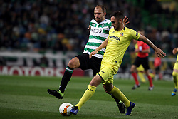 February 14, 2019 - Lisbon, Portugal - Sporting's forward Bas Dost from Holland (L) vies with Villarreal's defender Victor Ruiz  during the UEFA Europa League Round of 32 First Leg football match Sporting CP vs Villarreal CF at Alvalade stadium in Lisbon, Portugal on February 14, 2019. (Credit Image: © Pedro Fiuza/NurPhoto via ZUMA Press)
