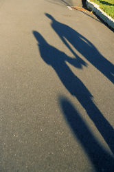 two people, couple holding hands, shadow. CONCEPT STOCK PHOTOS