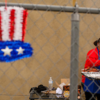 Cindy Joe tends to the grill during the Quilts of Honor ceremony at the University of New Mexico-Gallup North Campus in Gallup Friday.