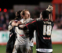 Photo: Leigh Quinnell.<br /> Tamworth v Stoke City. The FA Cup. 17/01/2006. Stoke keeper Steve Simonsen celebrates with Junior after winning the penalty shoot out.