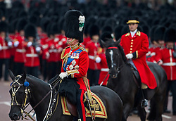 © London News Pictures. 13/06/2015. London, UK.  Prince Charles returning to Buckingham Palace on horseback during the annual Trooping the Colour Ceremony in central London. The event marks the queens official birthday. .Photo credit: Ben Cawthra/LNP