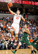 Nov. 12, 2010; Charlottesville, VA, USA; Virginia Cavaliers guard Billy Baron (15) shoots the ball in front of William & Mary Tribe guard Matt Rum (4) during the game at the John Paul Jones Arena. Virginia won 76-52.  Mandatory Credit: Andrew Shurtleff