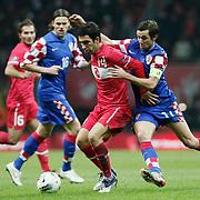 Turkey's Arda TURAN (C) and Croatia's Darijo SRNA (R) during their UEFA EURO 2012 Play-off for Final Tournament First leg soccer match Turkey betwen Croatia at TT Arena in Istanbul Nüovember11, 2011. Photo by TURKPIX