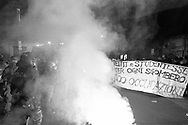 """Clash between the police and the protesters during the demostration in Roma organized by left movements after the eviction of the """"Nuovo Cinema Palazzo""""  community center in San Lorenzo neighborhood on 25 November, Italy."""
