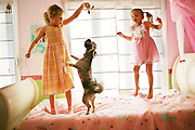 Piper and Scout playing with their dog Lulu at home in Knightdale, North Carolina.