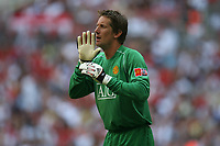 Photo: Rich Eaton.<br /> <br /> Manchester United v Chelsea. FA Community Shield. 05/08/2007. Manchester United's goalkeeper Edwin Van Der Sar shouts during the game, and went on to win the game with his penalty saves.