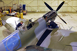 "© Licensed to London News Pictures. File picture dated 09/03/2012. Bristol, UK. Engineers race to finish work rebuilding a Mark IX Spitfire fighter circa 1943, at Filton airfield near Bristol. The plane has been rebuilt  by John Hart engineering, it is the last plane to be completed at the airfield and was flown out on 18 December 2012 by pilot Bill Perrins. Filton, the birthplace of the British-built Concorde jets, is to close on Friday (21st December 2012). Its owner BAE Systems says it is not viable and intends to sell it for housing and business development. BAE Systems said the airfield was closing following a comprehensive assessment over a five-year period and an independent review, ""both of which concluded that the airfield was not economically viable"".  Airbus has said it is fully committed to the Filton site, where it has a base making aircraft wings.  A spokesman said: ""The closure of the airfield will have no significant effect on our business and we have mitigation plans in place regarding the change of venue for our passenger shuttle (using Bristol airport) and the transportation of the A400M wings (via Portbury docks).  Planes currently based at Filton will have to find new homes. The airfield officially closes for flights this Friday, though the police helicopter will still be based there. BAE is supporting a new museum at Filton to ""house Concorde Alpha-Foxtrot and Bristol's aviation heritage."".Photo credit : Simon Chapman/LNP"