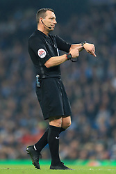 24th October 2017 - Carabao Cup (4th Round) - Manchester City v Wolverhampton Wanderers - Referee Kevin Friend points to his watch - Photo: Simon Stacpoole / Offside.
