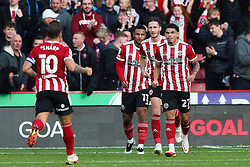 Sheffield United's Lys Mousset (second left) celebrates scoring his side's first goal during the Sky Bet Championship match at Bramall Lane, Sheffield. Picture date: Saturday October 16, 2021.