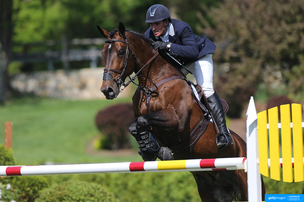 Quentin Judge riding HH Copin Van De Broy in action during the $100,000 Empire State Grand Prix presented by the Kincade Group during the Old Salem Farm Spring Horse Show, North Salem, New York,  USA. 17th May 2015. Photo Tim Clayton