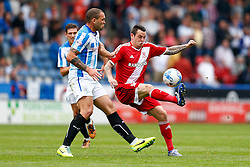 Lee Tomlin of Middlesbrough is challenged by Joel Lynch of Huddersfield - Photo mandatory by-line: Rogan Thomson/JMP - 07966 386802 - 13/09/2014 - SPORT - FOOTBALL - Huddersfield, England - The John Smith's Stadium - Huddersfield town v Middlesbrough - Sky Bet Championship.