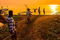 Fishermen haul in a fishing line at sunrise, Kinniya (near Trincomalee), Eastern Province, Sri Lanka.