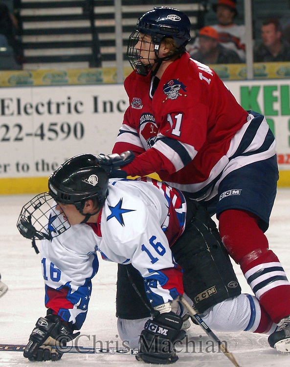 CM- 11/11/03 Council Bluffs, IA River City Lancer Michael Mullen gets knocked down by the  Des Moines Buccaneers' Travis Anderson Tuesday night at the Mid America Center...(photo by Chris MachianPrairie Pixel Group)