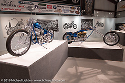 Seven Motorcycles' Takatoshi Suzuki's Skinny Teal custom 1967 Harley-Davidson Panhead (L) and Jack Deagazio's Tymeless 1982 Harley-Davidson XLCH Sportster Digger on display in the What's the Skinny Exhibition (2019 iteration of the Motorcycles as Art annual series) at the Sturgis Buffalo Chip during the Sturgis Black Hills Motorcycle Rally. SD, USA. Friday, August 9, 2019. Photography ©2019 Michael Lichter.