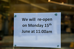 © Licensed to London News Pictures. 13/06/2020. London, UK. 'WE WILL RE-OPEN ON MONDAY 15th JUNE AT 11 AM' sign on display in River Island store's window in Wood Green, north London, as the store prepares to re-open on Monday. The government has announced that all non-essential retailers can re-open on Monday 15 June as the coronavirus lockdown restrictions are eased. Photo credit: Dinendra Haria/LNP
