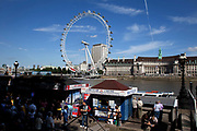 Tourists by the River Thames at Westminter, London. With the iconic London Eye behind this is one of the busiest areas for tourism in the city.