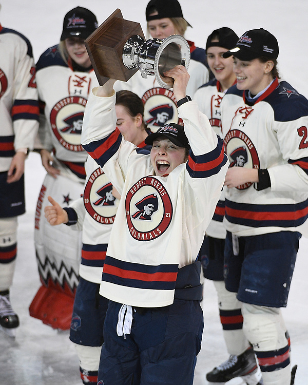 ERIE, PA - MARCH 06: Leah Marino #12 of the Robert Morris Colonials hoists the CHA Championship Trophy after the Colonials defeated the Syracuse Orange 1-0 in the championship game at the Erie Insurance Arena on March 6, 2021 in Erie, Pennsylvania. (Photo by Justin Berl/Robert Morris Athletics)