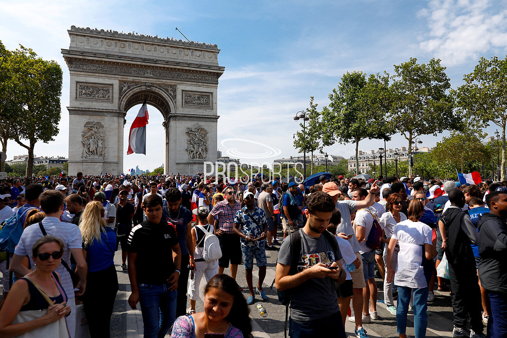 Crowd and flags new the Arc de Triophe during the parade of the team France on Champ-Elysées after winning the 2018 FIFA World Cup Russia on July 16, 2018 in Paris, France - Photo Frederic Le Floc'h / ProSportsImages / DPPI