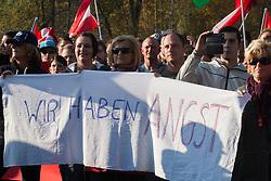 "Licensed to London News Pictures. 31/10/2015. Spielfeld, Austria. Anti-migrant protest in Spielfeld, Austria. ""We are afraid"" banner. Photo: Marko Vanovsek/LNP"