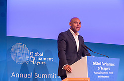 © Licensed to London News Pictures. 22/10/2018. Bristol, UK. Global Parliament of Mayors Annual Summit, 21-23 October 2018, at Bristol City Hall. Picture of MARVIN REES, Mayor of Bristol, UK, addressing the conference. The Global Parliament of Mayors 2018 is the biggest and most ambitious Annual Summit to date. GPM Bristol 2018 will host up to 100 global mayors for an action-focused summit that addresses some of the biggest challenges facing today's world cities. GPM Bristol 2018's theme, Empowering Cities as Drivers of Change, will focus minds on global governance and the urgent need for the influence, expertise and leadership of cities to be felt as international policy is shaped. GPM Bristol 2018 will provide mayoral delegates with a global network of connections and a space to develop the collective city voice necessary to drive positive change. The programme will engage participants in decision-making, with panels, debate and voting on priority issues including migration and inclusion, urban security and health, and is a unique chance to influence decisions on the most pressing issues of our time. Photo credit: Simon Chapman/LNP