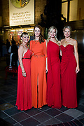 """Oct. 20, 2012 - Opera Carolina's annual Bella Notte fundraising gala is considered the most exclusive event in Charlotte. This formal, black-tie event turns out some of Charlotte's best-dressed. Women were encouraged to wear a shade of red. The evening was staged among the set of Puccini's """"Tosca"""" at Belk Theater Saturday, Oct. 20, 2012. PHOTO BY WENDY YANG"""