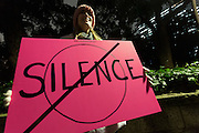A woman holds a sign calling on Democrats to not keep silent at a protest march by members of the Democratic Party Abroad organisation to mark the inauguration of President Donald Trump, Tokyo, Japan. Friday January 20th 2017 Around 400 people took apart in the march, which started in Hibiya Park at 6:30pm and finished in Roppongi just before 8pm, to honour the service given by President Obama and to protest against the illiberal policies expected of the new administration of President  Trump.