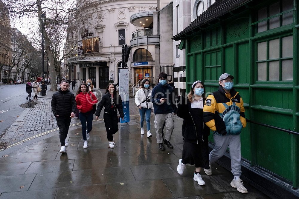People wearing face masks out and about as the Prime Minister announces a new tighter fourth tier of local coronavirus restrictions for London and the South East, and that the planned Christmas relaxation of the rules was to be scrapped on 19th December 2020 in London, United Kingdom. These shoppers, mostly wearing face masks were unaware, as were shop owners that the new rules were about to be announced, and this would mean that all non-essential shops will have to close from midnight.
