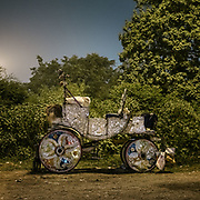 A horse carriage, also called buggy. On the edge of the city, horses are kept under highway bridges at night while their owner sleeps nearby. The horses are used to pull horse carriage for tourists during the day.