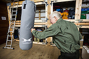 Geophysicist Antoine Kies exercises with a punching bag at the Polish Polar Station in Hornsund, Svalbard.