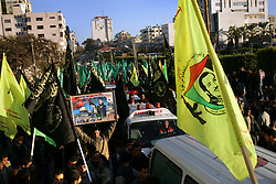 Palestinians mourn the bodies of 15 dead militants just returned, after being held by Israel, Gaza, Palestinian Territories, Feb. 7, 2005. The Israeli military delivered the bodies for burial, a handover celebrated as the first real achievement of leader Mahmoud Abbas, also known as Abu Mazen, who is trying to prevent militants from straying from a fragile truce.