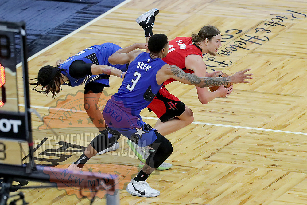 ORLANDO, FL - APRIL 18: Kelly Olynyk #41 of the Houston Rockets escapes as Cole Anthony #50 of the Orlando Magic and Chuma Okeke #3 of the Orlando Magic attempt to foul him late in the second half at Amway Center on April 18, 2021 in Orlando, Florida. NOTE TO USER: User expressly acknowledges and agrees that, by downloading and or using this photograph, User is consenting to the terms and conditions of the Getty Images License Agreement. (Photo by Alex Menendez/Getty Images)*** Local Caption *** Kelly Olynyk; Cole Anthony; Chuma Okeke