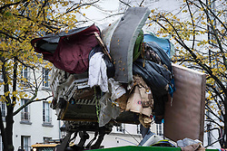November 4, 2016 - Paris, France - A bulldozer removes tents after an evacuation of a makeshift camp near Stalingrad metro station in Paris on November 4, 2016, one of several camps sprouting up around the French capital. Over 2000 migrants were moved by police from the Paris town center to a legal migrant camp. (Credit Image: © Julien Mattia/NurPhoto via ZUMA Press)