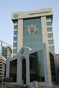 Bank buildings in the modern downtown section of Kuwait City, Kuwait along the Persian Gulf of the Arabian Sea.  The crown prince, Sheikh Saad Al-Abdallah Al-Sabah is pictured on the building.