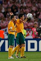Photo: Glyn Thomas.<br />Croatia v Australia. Group F, FIFA World Cup 2006. 22/06/2006.<br /> Australia's Harry Kewell (R) celebrates as his team reaches the second round.
