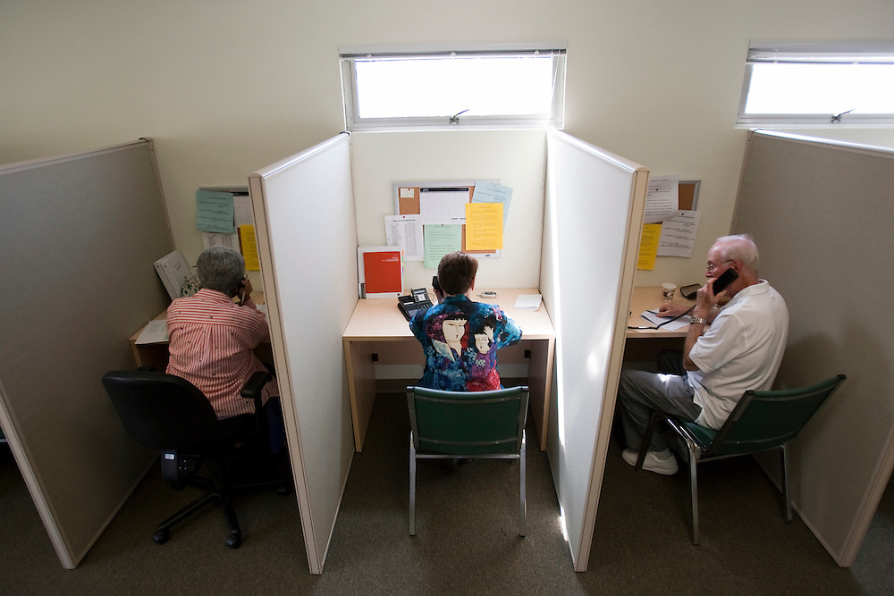 Harriet Kossovo, left, Mary Fenton, center, and Barry Greenberg, right, volunteer as Fraud Fighters at the WISE and Healthy Aging facility in Santa Monica, CA where they phone senior citizens to warn them of phone fraud.