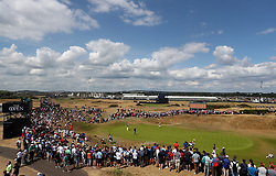 Northern Ireland's Rory McIlroy, Australia's Marc Leishman and Denmark's Thorbjorn Olesen on the 1st green during day one of The Open Championship 2018 at Carnoustie Golf Links, Angus.