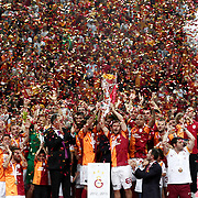 Galatasaray players celebrate with the trophy after their Turkish Super League soccer match against Trabzonspor at Turk Telekom Arena stadium May 18, 2013.Galatasaray won the Turkish league title for the 19th time. Photo by TURKPIX