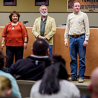 Gallup McKinley County Schools board members stand to recognize area athletes during the GMCS board meeting at the Student Support Center in Gallup Monday.